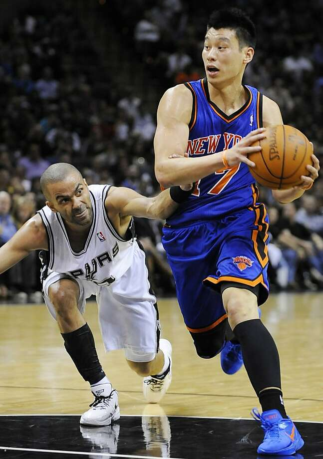 New York Knicks' Jeremy Lin, right, drives around San Antonio Spurs' Tony Parker, of France, during the first half of an NBA basketball game on Wednesday, March 7, 2012, in San Antonio. (AP Photo/Darren Abate) Photo: Darren Abate, Associated Press