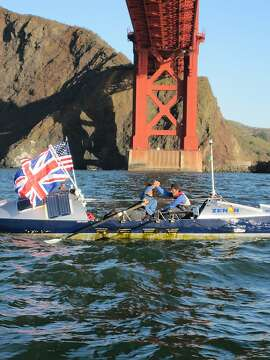 Chris Martin (left) and Mick Lawson arrive in San Francisco, Calif., on Nov. 13, 2009 after spending more than six months at sea. The two British rowers traveled more than 6,000 miles across the Pacific Ocean over the course of six months.