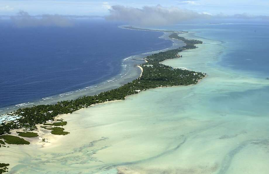 A man is seeking asylum because rising sea levels threaten his home in Kiribati, seen here. Photo: Richard Vogel, Associated Press