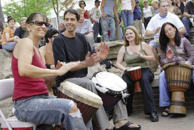 All images should be credited to Asheville Convention & Visitors Bureau (or Asheville CVB). Pritchard Park Drum Circle.jpg Asheville residents and tourists gather in public parks and downtown squares to play bongos and share other musical traditions. The Pritchard Park Drum Circle, shown here, is a Friday ritual. / handout