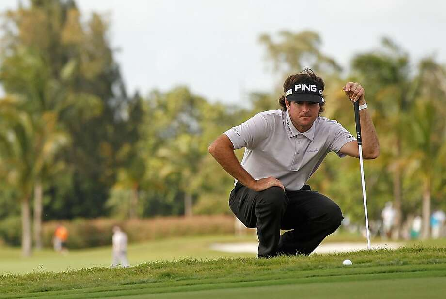 Bubba Watson lines up a putt on the ninth hole during the second round of the 2012 World Golf Championships Cadillac Championship at Doral Golf Resort And Spa on March 9, 2012 in Miami, Florida. Photo: Mike Ehrmann, Getty Images