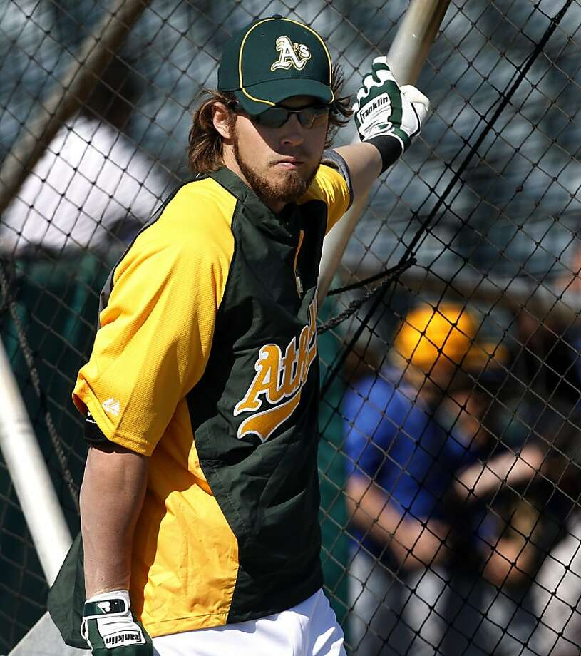 Josh Reddick prepares for batting practice before the A's Cactus League spring training opener against the Seattle Mariners in Phoenix, Ariz. on Friday, March 2, 2012. Photo: Paul Chinn, The Chronicle