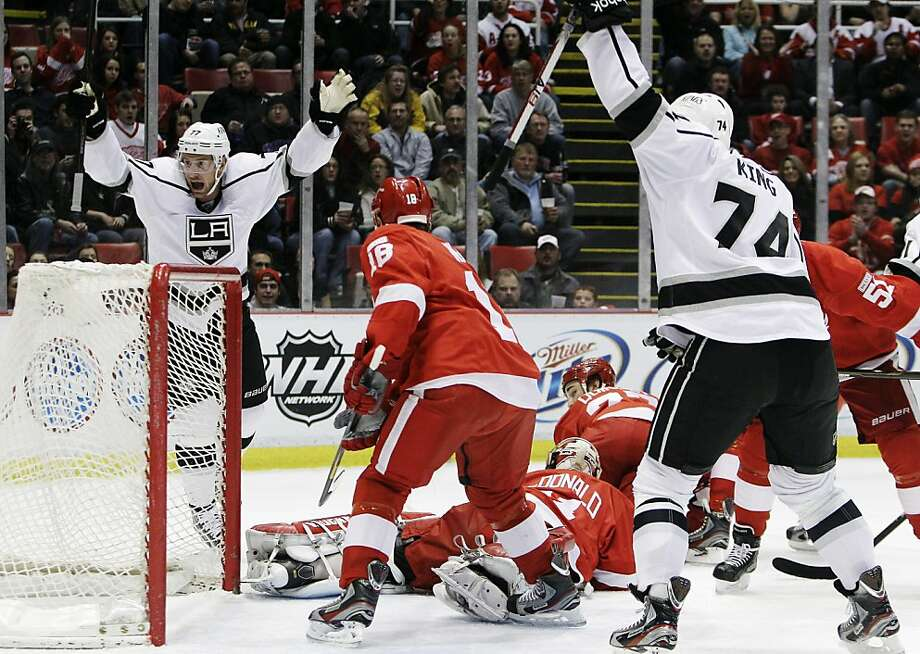 Los Angeles Kings center Jeff Carter (77) celebrates his goal against Detroit Red Wings goalie Joey MacDonald (31) during the first period of an NHL hockey game in Detroit, Friday, March 9, 2012. At right is Los Angeles Kings left wing Dwight King (74). Photo: Carlos Osorio, Associated Press