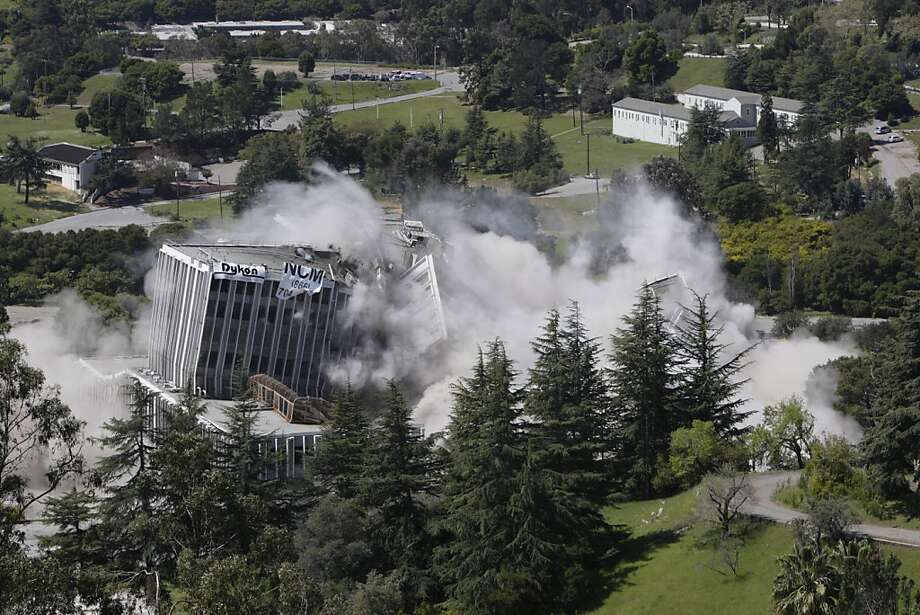 The Oak Knoll Hospital is imploded on Friday, April 8, 2011 in Oakland, Calif. The main hospital building at the 167-acre, former Oak Knoll U.S. Naval Medical Center in Oakland, Calif. is the last Navy structure to be demolished. Photo: Lea Suzuki, The Chronicle