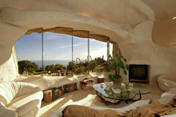 """A whimsical house in Malibu, California, that looks like something out of """"The Flintstones"""" has come on the market at $3.5 million. The owners are television personality Dick Clark and his wife, Kari."""