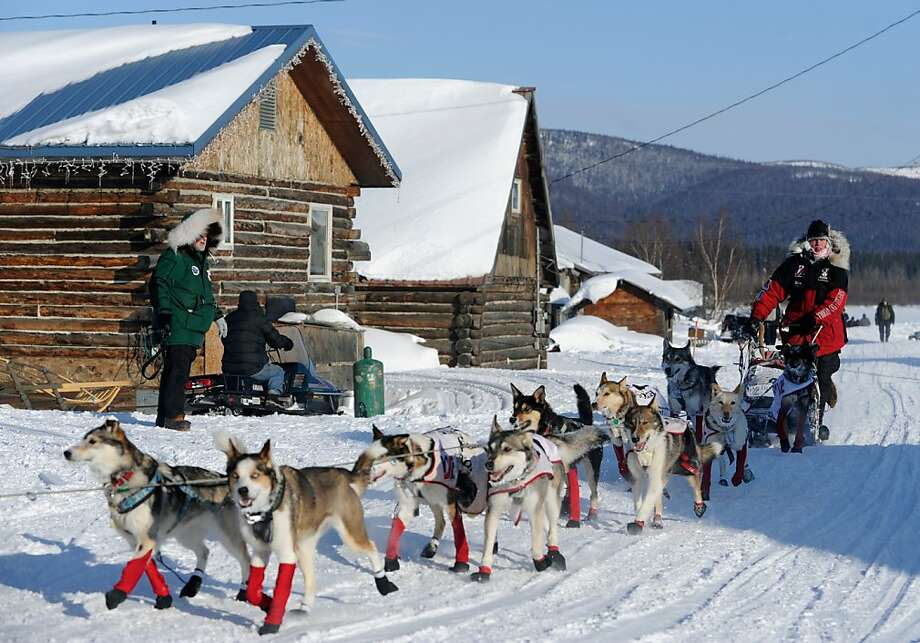 Aliy Zirkle arrives at the Kaltag checkpoint of the Iditarod Trail Sled Dog Race on Saturday, March 10, 2012 in Kaltag, Alaska. (AP Photo/The Anchorage Daily News, Marc Lester) Photo: Marc Lester, Associated Press