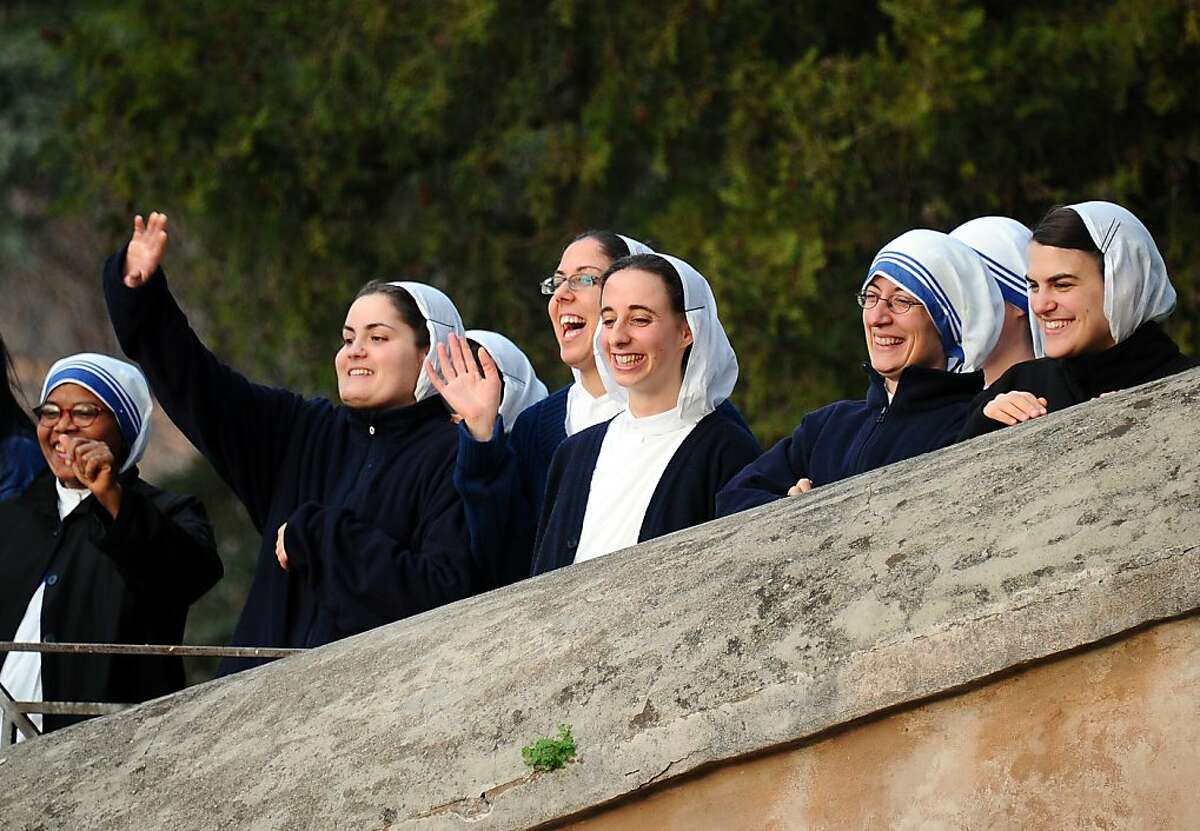 Nuns wave to Popeupon his arrival together with Archbishop of Cantebury to celebrate the Vesper prayer in the Rome' s San Gregorio al Celio church on March 10, 2012. TOPSHOTS/AFP PHOTO/VINCENZO PINTO (Photo credit should read VINCENZO PINTO/AFP/Getty Images)