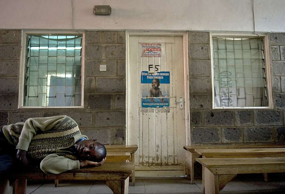 An ill boy lies on March 9, 2012 on a bench at Mbagathi District Hospital in Nairobi, where a nurses strike has brought operations at the facility almost to a halt. Kenya's public hospitals face a potentially devastating health worker shortage after the government said Thursday it had fired 25,000 striking nurses. The nurses went on strike March 1 to protest the government's failure to implement a salary increase agreed last year, when they also stopped work to press for improved services in Kenya's mostly ill-equipped public hospitals. AFP PHOTO/Tony KARUMBA (Photo credit should read TONY KARUMBA/AFP/Getty Images) Photo: Tony Karumba, AFP/Getty Images