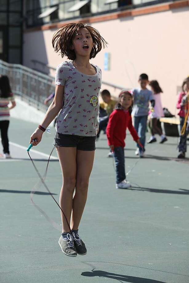 Leila Lee-Mundschau, 10 years old in fifth grade, at Lawton Alternative School in San Francisco, Calif., jumping rope to raise money for the American Heart Association on Friday, March 9, 2012.  Jump Rope for Heart is a national fundraising program that promotes physical activity and community service which Lawton Alternative school has been participating for the last seven years. Photo: Liz Hafalia, The Chronicle