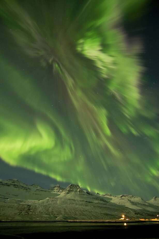 Awesome aurora: The solar storm that shook the Earth's magnetic field Thursday and Friday appears to have spared electrical systems, but it sure juiced up the northern lights in Faskusfjordur, Iceland. Photo: Jonina Oskardottir, Associated Press