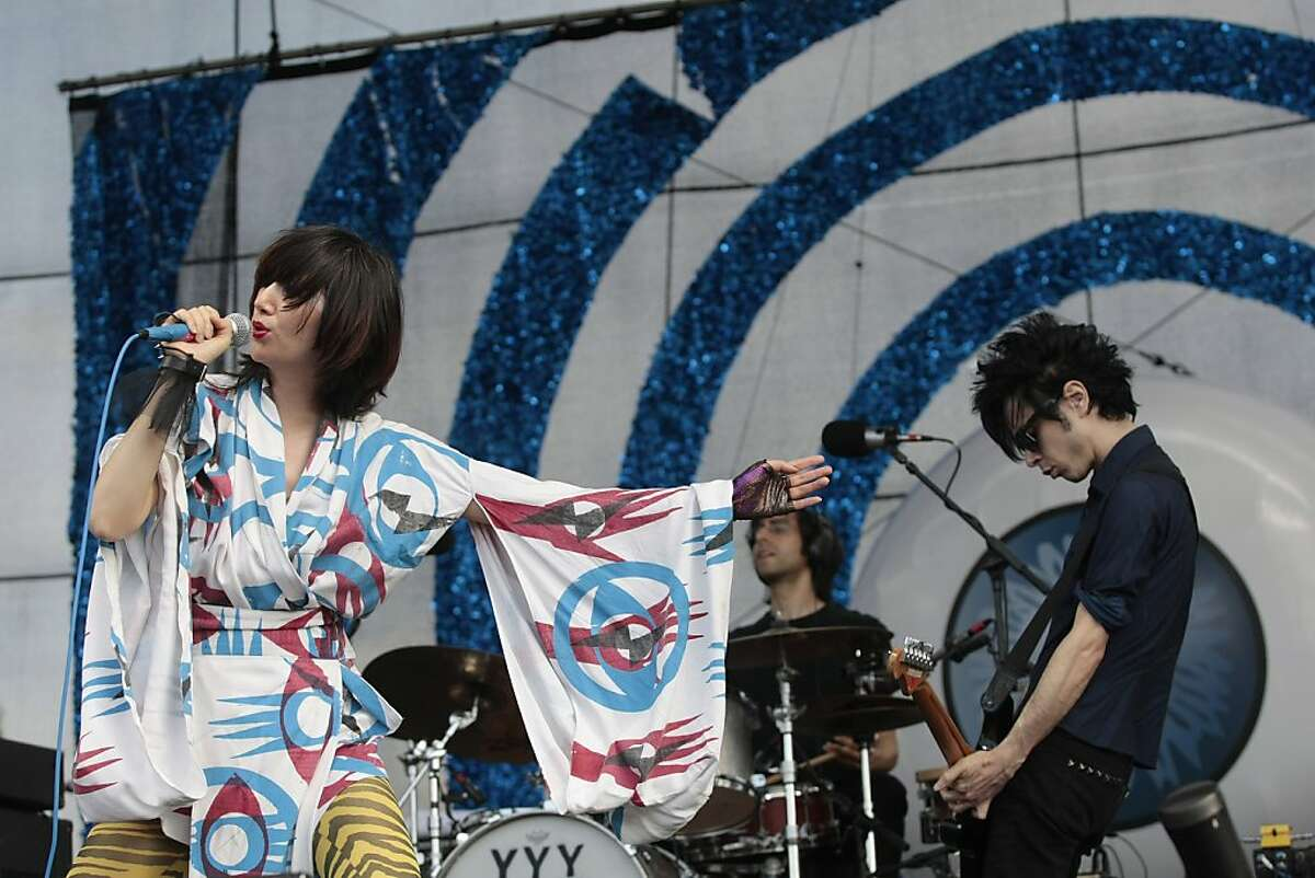 The Yeah Yeah Yeahs, featuring Karen O, left, drummer Brian Chase and guitarist Nick Zinner performs during the Bonnaroo Arts and Music Festival in Manchester, Tenn., Friday, June 12, 2009. (AP Photo/Dave Martin)