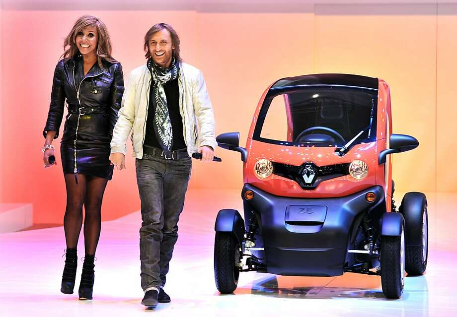 French DJ David Guetta and his wife Cathy pose with a Renault Twizy model car on March 6, 2012 during a press day ahead of the 82nd Geneva Motor Show in Geneva. Some 700 carmakers hold a press preview of their newest batch of automobiles at the Geneva Motor Show, which opens to the public from March 8 to 18. Photo: Sebastien Feval, AFP/Getty Images