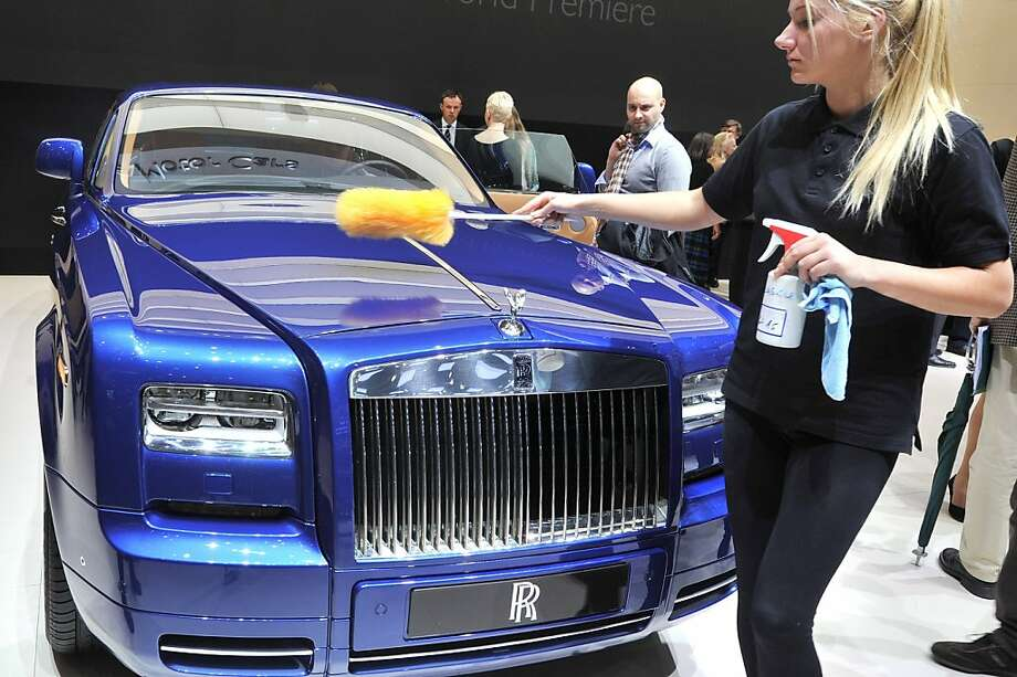 A Rolls Royce is cleaned at English car maker's booth  during a press day ahead of the 82nd Geneva Motor Show on March 6, 2012 in Geneva. Some 700 car makers hold a press preview of their newest batch of automobiles at the Show, which opens to the public from March 8 to 18. Photo: Sebastien Feval, AFP/Getty Images