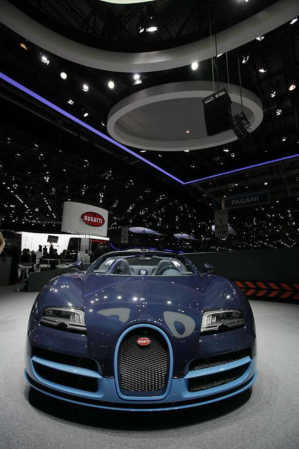 A Bugatti Grand Sport Vitesse automobile sits on display during the first press day of the Geneva International Motor Show in Geneva, Switzerland, on Tuesday, March 6, 2012. The 82nd Geneva International Motor Show will showcase the latest models from the auto industry's leading manufacturers at the Palexpo exhibition center this week. Photo: Jason Alden, Bloomberg