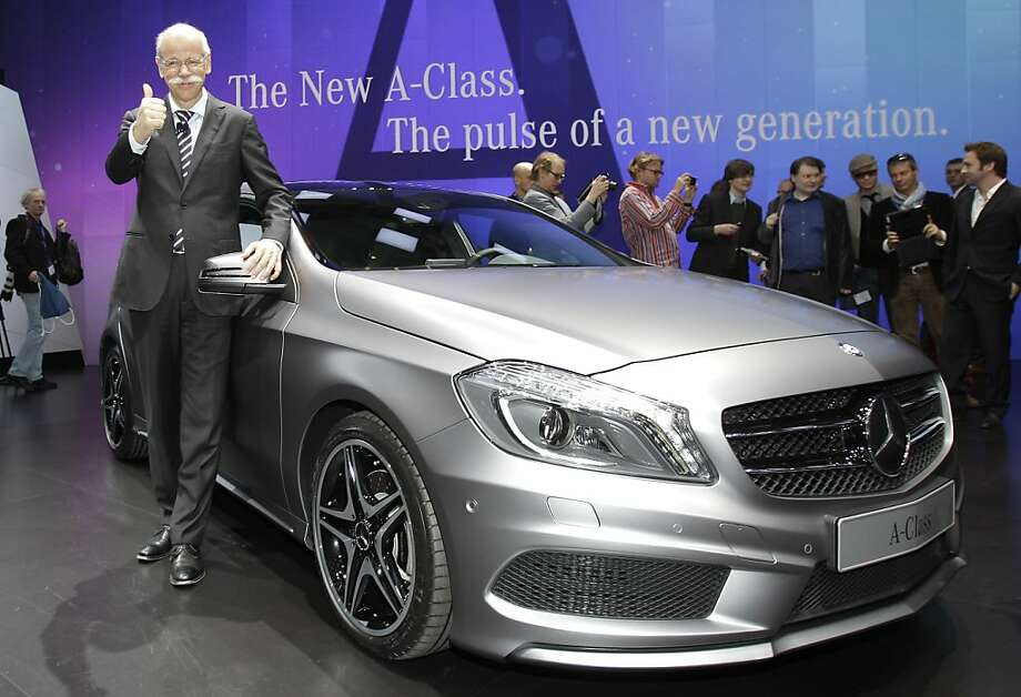 Dieter Zetsche, left, CEO of Daimler AG and Mercedes Benz cars, introduces the new A-Class on Tuesday, March 6, 2012 during the press preview days at the 82nd Geneva International Motor Show in Geneva, Switzerland. The Motor Show will open it's doors to the public from March 8 to 18, presenting more than 260 exhibitors and more than 180 world and European premieres. Photo: Frank Augstein, Associated Press