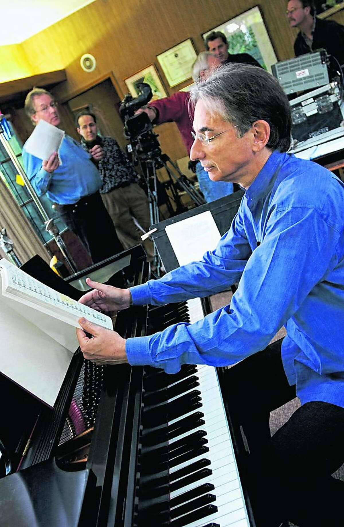 Michael Tilson Thomas reviews an Aaron Copland score at the the piano during the taping of the