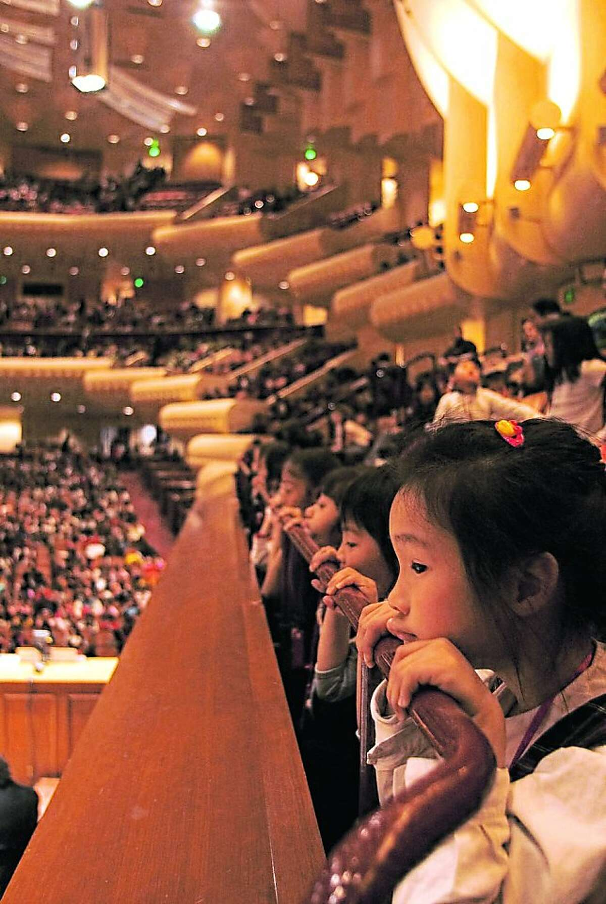 Music for all/education: Children enjoy a free SF Symphony performance as part of their Adventures in Music program.