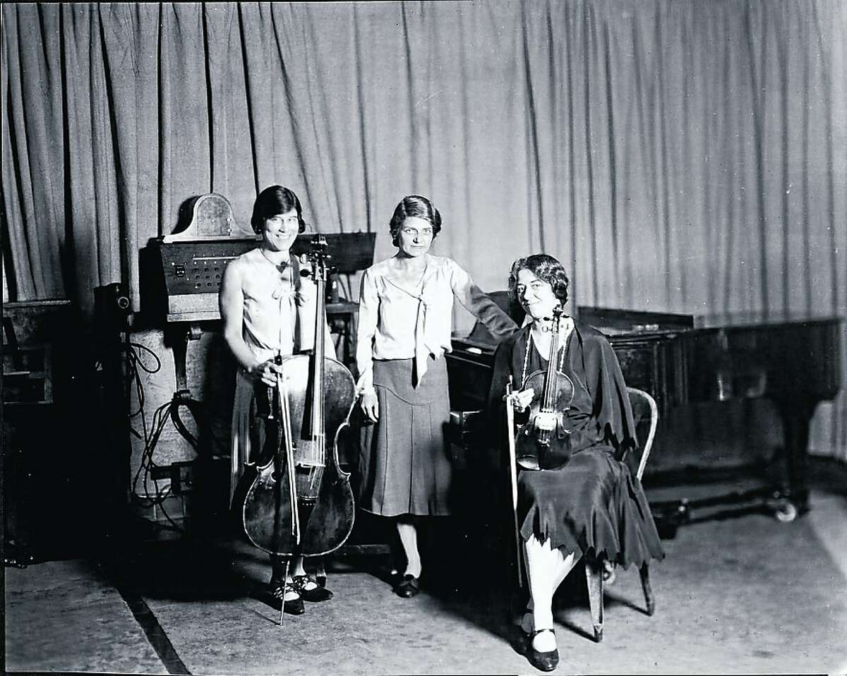 The Pasmore Trio: Cellist Dorothy Pasmore (left) and her violinist sister Mary (right), shown here with their pianist sister Suzanne.Picasa 3.0/