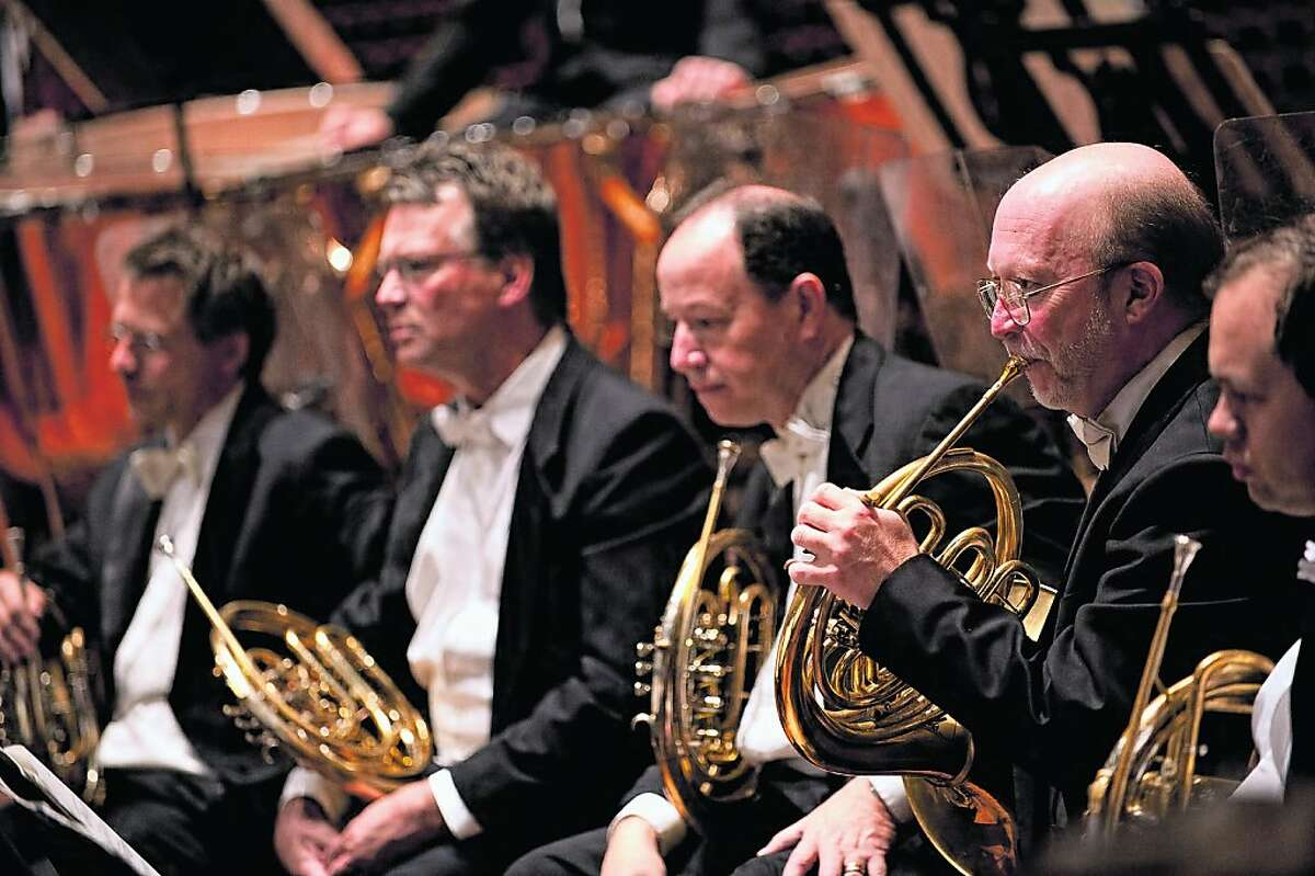 Musicians: SF Symphony Horn section, with Principal Bob Ward, playing, second from right.