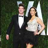 Singer Robin Thicke (L) and actress Paula Patton arrive at the 2012 Vanity Fair Oscar Party hosted by Graydon Carter at Sunset Tower on February 26, 2012 in West Hollywood, California.