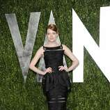 Emma Stone arrives at the Vanity Fair Oscar party on Sunday, Feb. 26, 2012, in West Hollywood, Calif. (AP Photo/Evan Agostini)