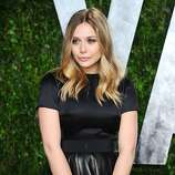WEST HOLLYWOOD, CA - FEBRUARY 26:  Actress Elizabeth Olsen arrives at the 2012 Vanity Fair Oscar Party hosted by Graydon Carter at Sunset Tower on February 26, 2012 in West Hollywood, California.  (Photo by Alberto E. Rodriguez/Getty Images)