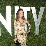 Kate Beckinsale arrives at the Vanity Fair Oscar party on Sunday, Feb. 26, 2012, in West Hollywood, Calif. (AP Photo/Evan Agostini)