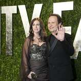 Billy Crystal (R) and wife Janice Goldfinger arrive to the Vanity Fair Oscar Party for the 84th Annual Academy Awards at the Sunset Tower on February 26, 2012 in West Hollywood, California.    AFP PHOTO / ADRIAN SANCHEZ-GONZALEZ (Photo credit should read ADRIAN SANCHEZ-GONZALEZ/AFP/Getty Images)