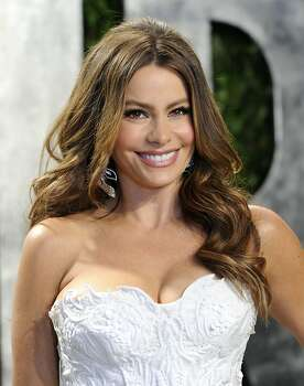 Sofia Vergara arrives at the Vanity Fair Oscar party on Sunday, Feb. 26, 2012, in West Hollywood, Calif. (AP Photo/Evan Agostini) Photo: Evan Agostini, Associated Press