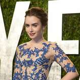Lily Collins arrives at the Vanity Fair Oscar Party, for the 84th Annual Academy Awards, at the Sunset Tower on February 26, 2012 in West Hollywood, California. AFP PHOTO / ADRIAN SANCHEZ-GONZALEZ (Photo credit should read ADRIAN SANCHEZ-GONZALEZ/AFP/Getty Images)