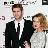 LOS ANGELES, CA - FEBRUARY 26:  Actor Liam Hemsworth and singer/actress Miley Cyrus arrive at the 20th Annual Elton John AIDS Foundation's Oscar Viewing Party held at West Hollywood Park on February 26, 2012 in West Hollywood, California.  (Photo by Frederick M. Brown/Getty Images)