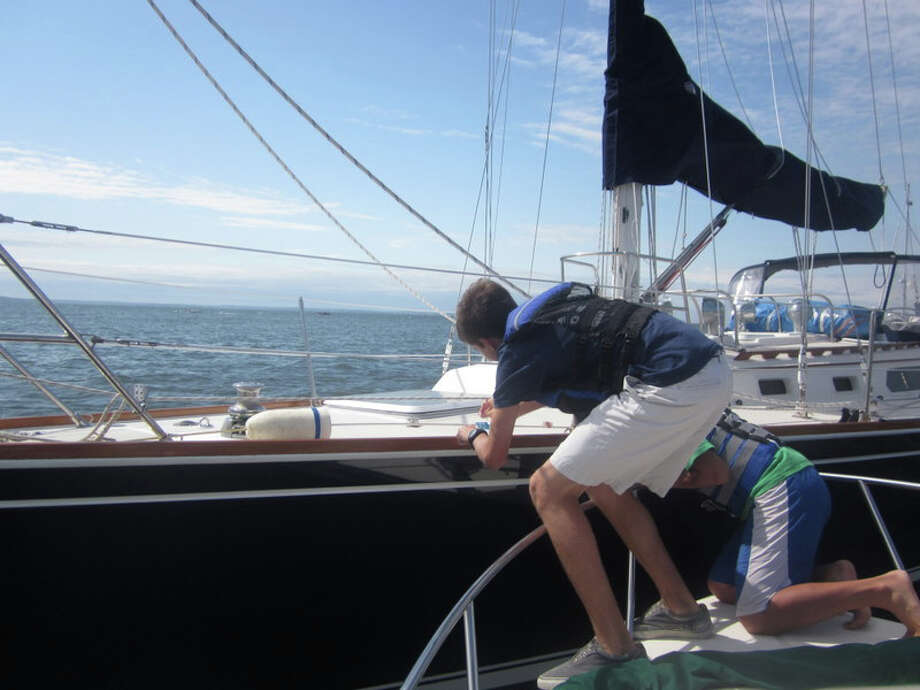 Eagle Scout candidate Michael Johnston, left, focused on Darien Harbor for his Eagle Scout project. At right, Holden Chung. Photo: Contributed Photo