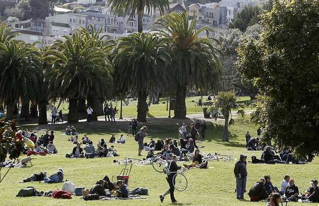 "People enjoy Dolores Park in the Mission District of  San Francisco, Ca. on Saturday March 10, 2012. Efforts are underway by the City of San Francisco to upgrade the park which is being, ""loved to death"" by thousands of people each day. Photo: Michael Macor, SFC"