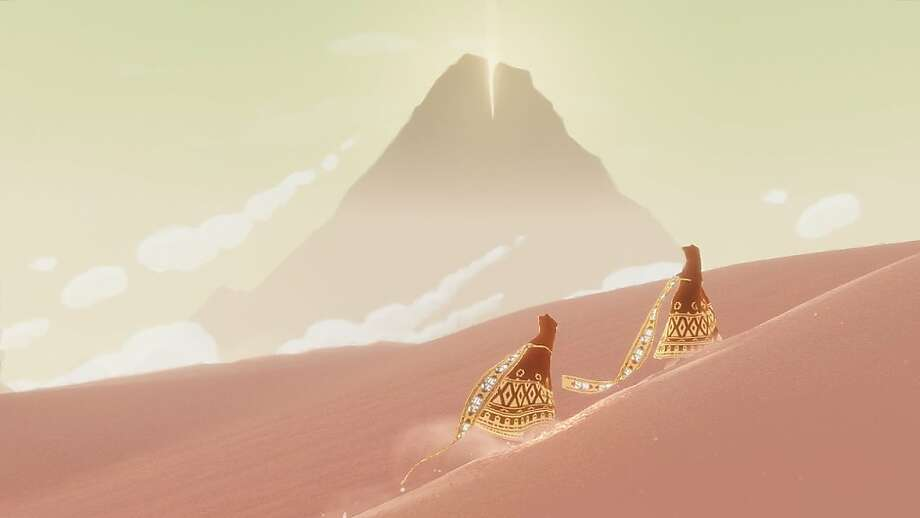 Journey follows you and a fellow traveler on a pilgrimage to the top of a mountain. Photo: Sony