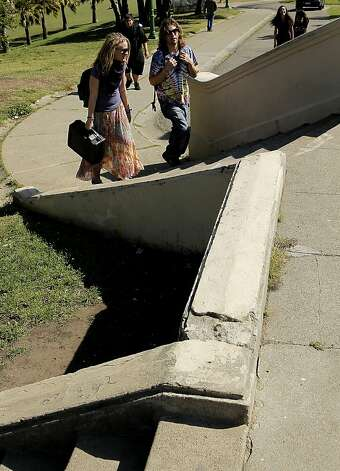 "Some of the walkways through the park are showing their age, at Dolores Park in the Mission District of  San Francisco, Ca. on Friday March 9, 2012. Efforts by the City of San Francisco are underway to upgrade the park, which is being, ""loved to death"" by thousands of people each day. Photo: Michael Macor, SFC"