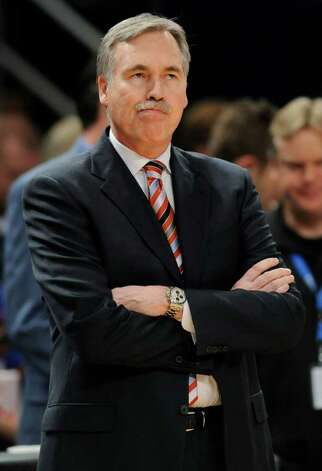 FILE - In this Feb. 4, 2012 file photo, New York Knicks coach Mike D'Antoni looks on before the start of an NBA basketball game against the New Jersey Nets, at Madison Square Garden in New York. A person with knowledge of the decision says D'Antoni has resigned. The person spoke to The Associated Press on the condition of anonymity because the team had yet to announce the move. Photo: AP