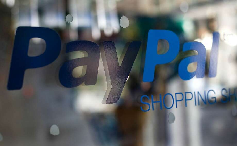 PayPal Inc. signage is displayed at the company's shopping showroom in New York, U.S., on Tuesday, Nov. 1, 2011. Scott Thompson, president of Ebay Inc.'s PayPal unit, discussed the company's plan to expand its cloud-based mobile-payment system to U.S. and European retailers and the outlook for use of near-field communications (NFC) technology for the system. Photographer: Michael Nagle/Bloomberg Photo: Michael Nagle, Bloomberg