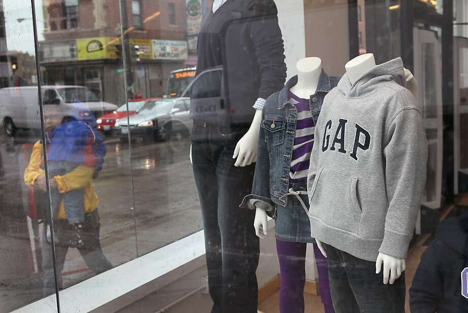 CHICAGO, IL - OCTOBER 13: Mannequins sit in the window of a GAP store on October 13, 2011 in Chicago, Illinois. Gap Inc. plans to reduce the number of Gap brand stores to 700 in North America, closing roughly one-third of their existing stores by the endof 2013. Photo: Scott Olson, Getty Images