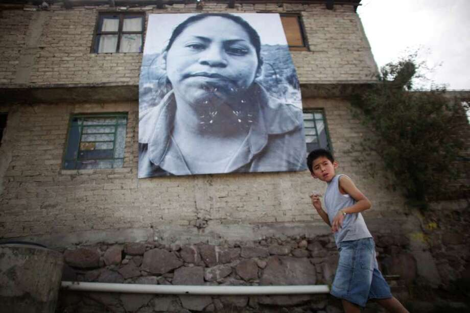 In Ecatepec, outside of Mexico City, images of people who were victims of crime are displayed as part of a campaign against violence. Photo: Alexandre Meneghini, Associated Press