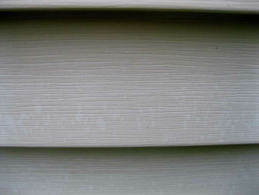 The vinyl siding at the home of Eugene and Melanie Dallas is spotted with bleached spots. They believe a Ballston Spa-based contractor is to blame. (Photo submitted by Eugene Dallas)