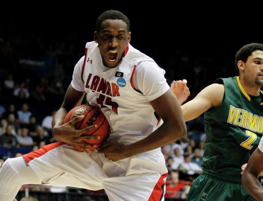 Lamar forward Stan Brown (35) pulls a rebound away from Vermont forward Luke Apfeld (2) during the first half of an NCAA tournament first-round college basketball game, Wednesday, March 14, 2012, in Dayton, Ohio. (AP Photo/Skip Peterson) Photo: Skip Peterson / FR23879 AP