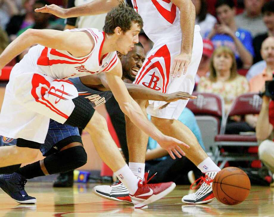 Houston Rockets point guard Goran Dragic (3) steals from Charlotte Bobcats point guard Kemba Walker (1) and runs across court to score for the Rockets in the first period during the basketball game at Toyota Center on Wednesday, March 14, 2012, in Houston. Photo: Mayra Beltran, Houston Chronicle / © 2012 Houston Chronicle