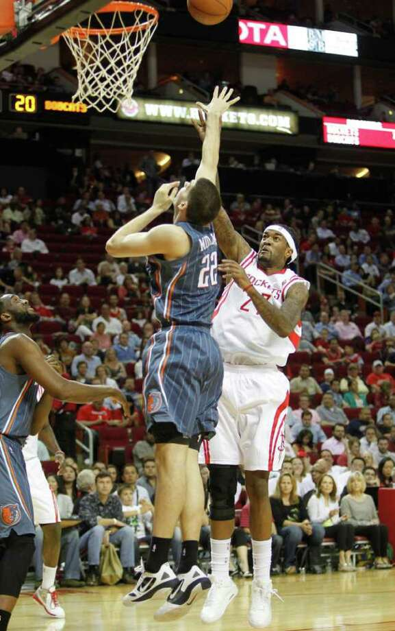 Houston Rockets center Jordan Hill (27) scores over Charlotte Bobcats center Byron Mullens (22) second period during the basketball game at Toyota Center on Wednesday, March 14, 2012, in Houston. Photo: Mayra Beltran, Houston Chronicle / © 2012 Houston Chronicle
