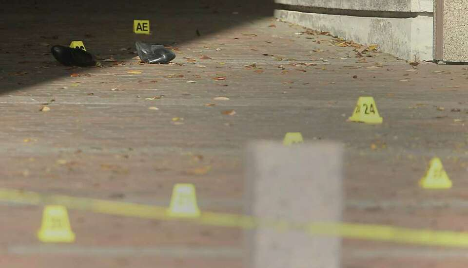 Shoes and bullet casings lie strewn about on the steps of the Jefferson County Courhouse hours after