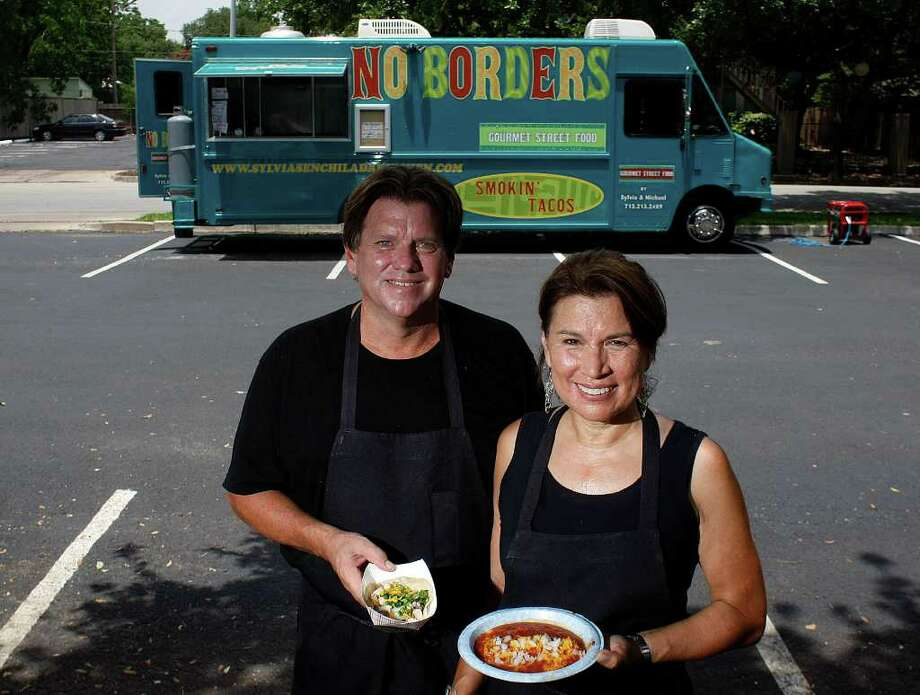 Michael Warren, left, ex-boyfriend of Sylvia Casares, right, launched the No Borders food truck in March 2011. Warren pleaded guilty to aggravated assault with a deadly weapon Tuesday afternoon in Casares' shooting two years ago. Photo: Johnny Hanson / © 2011 Houston Chronicle