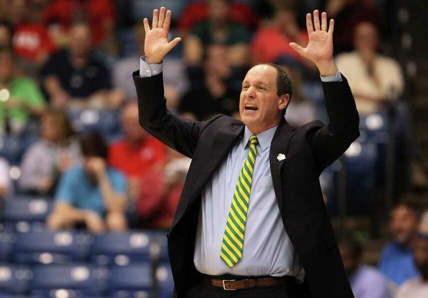 DAYTON, OH - MARCH 14:  Head coach John Becker of the Vermont Catamounts reacts as he coaches agains