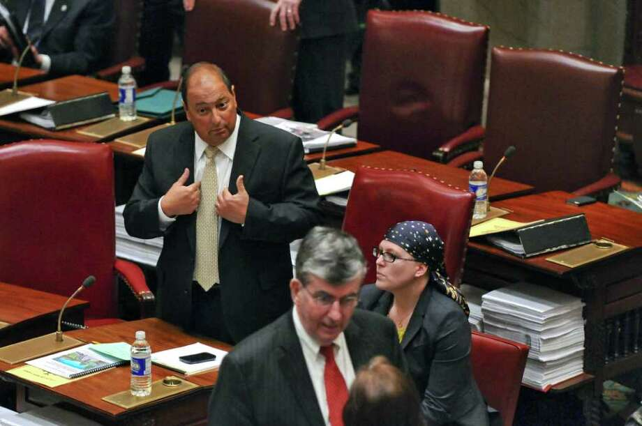 State Senator Tom Libous, Deputy Majority Leader, left, speaks on the floor of the Senate chamber to say that the senate was in for a long night  considering bills, on Wednesday night March 14, 2012 in Albany, N.Y. State Senator Neil D. Breslin, Deputy Minority Leader, is in the foreground. (Philip Kamrass / Times Union ) Photo: Philip Kamrass