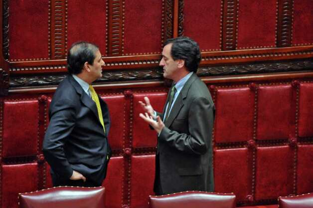 State Senators Andrew J. Lanza, left, and Charles J. Fuschillo, Jr., right, both Republicans, speak on the floor of the Senate chamber  on Wednesday night March 14, 2012 in Albany, N.Y. (Philip Kamrass / Times Union ) Photo: Philip Kamrass