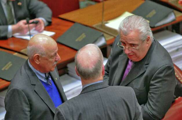 State Senators Kenneth P.  LaValle left, and Carl L. Marcellino, right, both Republicans, speak on the floor of the Senate chamber  on Wednesday night March 14, 2012 in Albany, N.Y. (Philip Kamrass / Times Union ) Photo: Philip Kamrass