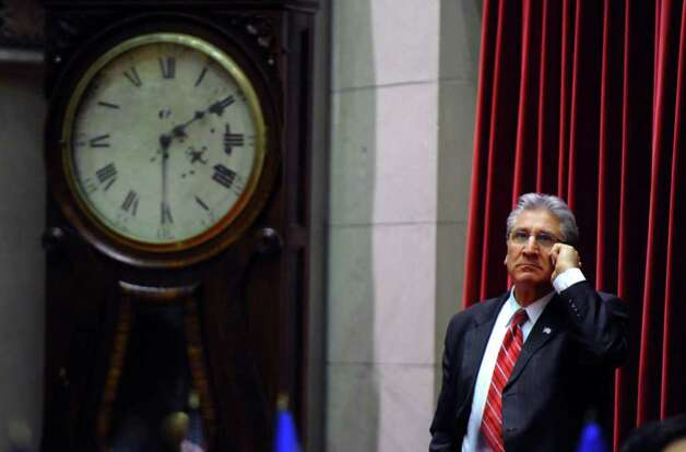 Assemblyman James Tedisco waits in the Assembly chamber  on Wednesday night March 14, 2012 in Albany, N.Y. The clock at left, dating from 1835, a wall clock that was in the Assembly chamber, does not work. (Philip Kamrass / Times Union ) Photo: Philip Kamrass